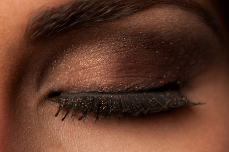 Closeup of eye with strong makeup shadow