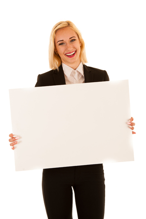 Attractive business woman hilding blank white banner isolated over white background
