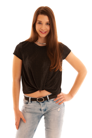 Portraiz of a beautiful caucasian teenage girl in black shirt and jeans isolated over white