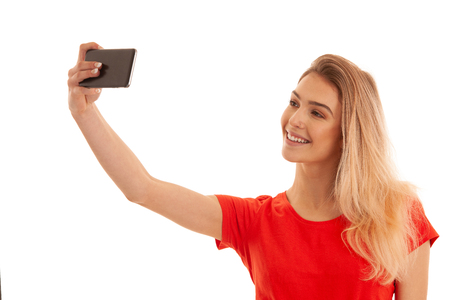 Beautiful young caucasian woman taking selfie photo isolated over white background