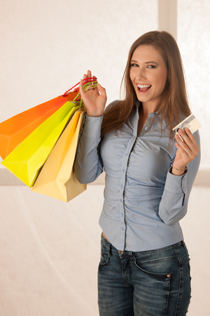 attractive young woman wtih shopping bags after purchasing in mall Stock Photo
