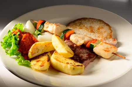 Mixed Grilled meat and vegetables decorated on a plate ready to be served in restaurant