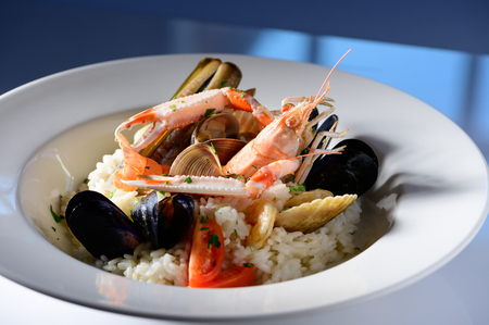Rice with seafood on a plate in restauant ready to be served Stock Photo