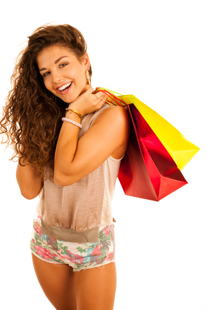 Attractive young caucasian woman with shopping bags isolated over white background Stok Fotoğraf