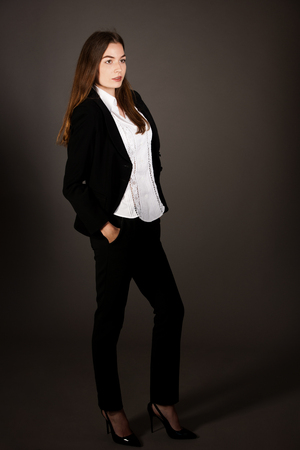 attractive business woman - full length corporative portrait islated over gray background Imagens
