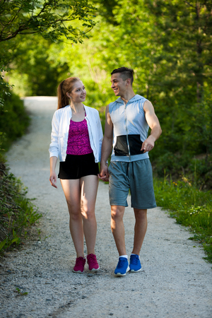 Active young couple on a wlak in the park