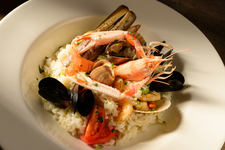 Rice with seafood on a plate in restauant ready to be served Stockfoto