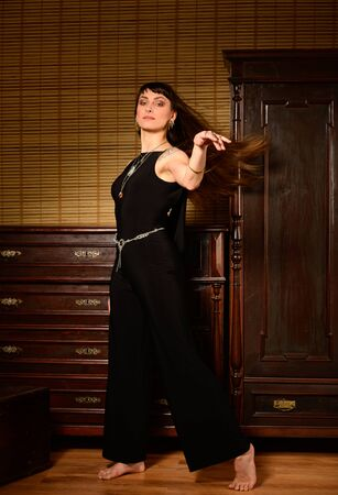 Hip hop dancer in an ancient furnitured room