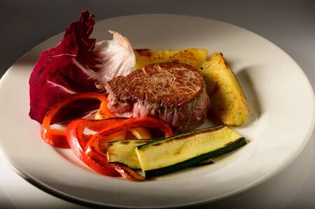 roasted beef steak with vegetable decorated and searved on a plate Stock Photo