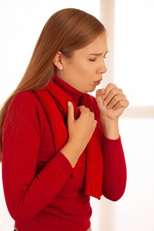 Young ill  woman cough as she got cold and flu - illness strike . Foto de archivo