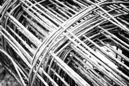 bundled: Background of Iron and bundled bars ready for construction with black and white color