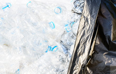 utilize: Plastic water bottles with garbage bag ready for recycle Stock Photo