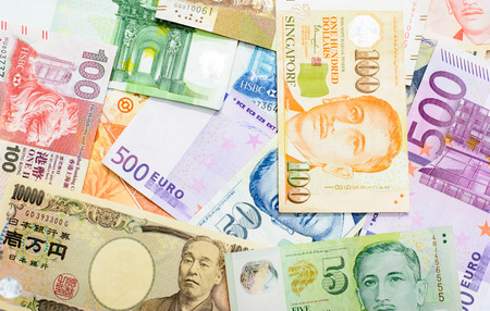 Colorful background of many currency,money profit from business with many country 写真素材