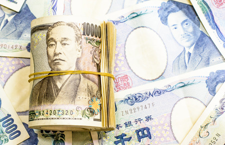 Background of  Japanese currency.Focus on roll of 10000 banknote