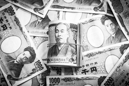 Background of  Japanese currency with black and white color.Focus on roll of 10000 banknote on the middle 写真素材