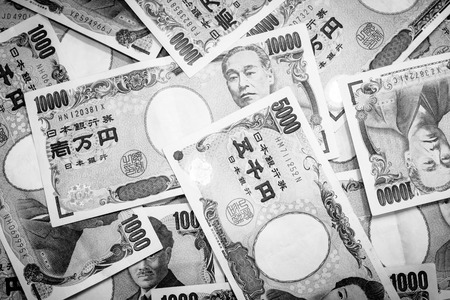 Success and got profit from business with Japanese currency background on black and white color 写真素材