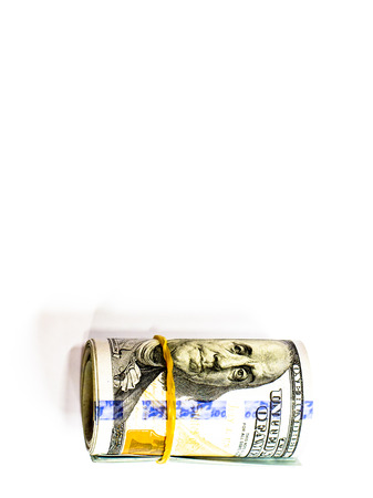 Roll background of hundred  dollars notes and shadow with white background