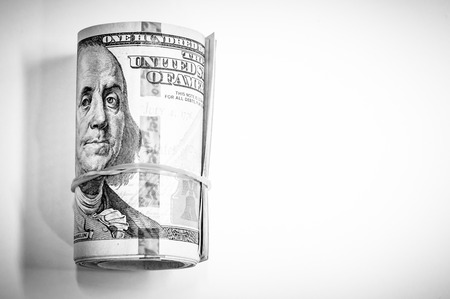Roll background of hundred  dollars notes with black and white color 写真素材