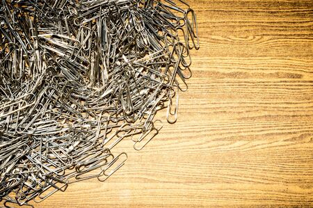Background of many paper clip put on the wooden desk Stock fotó