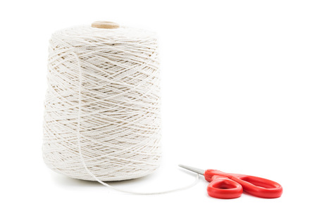 roll of white rope isolated with red scissors