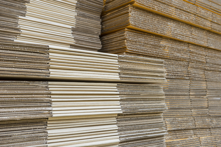 flattened: stack of corrugated cardboard boxes. egde view of flattened boxes. Stock Photo