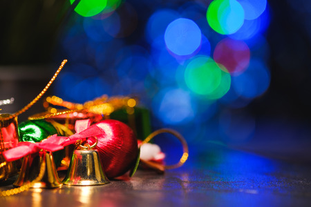 christmas ornaments with background of bokeh blurred lighting, low key picture Stock Photo