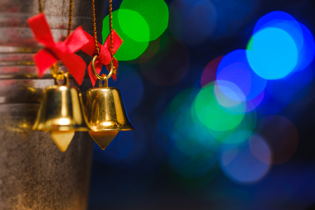 christmas bells decorations with background of bokeh blurred lighting, low key picture Stock Photo