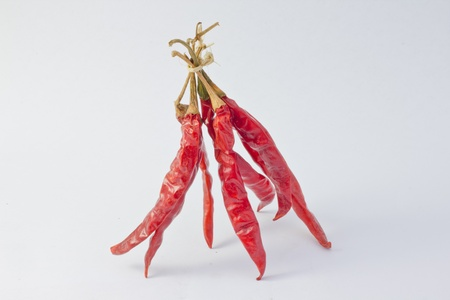 Bunch dried hot chilli pepers isolate on white background-2