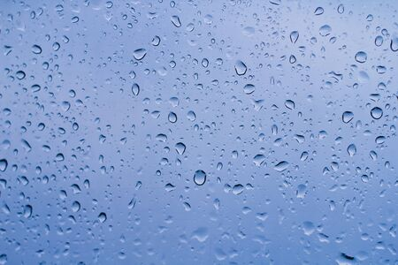 Close-up of water drops on glass surface as background._ Standard-Bild