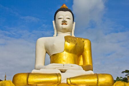 huge golden buddha statue in the sitting position in Thailand