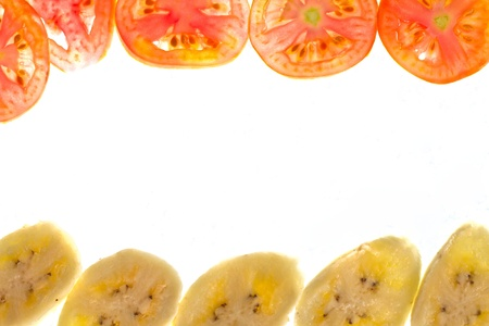 Pieces of sliced tomato and banana frame
