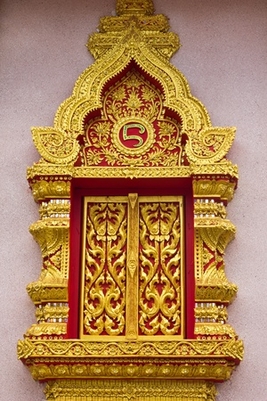 Ancient Golden window of Thai temple photo