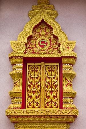 Ancient Golden window of Thai temple