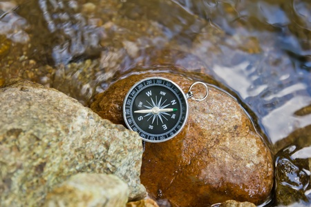 compass on the rock
