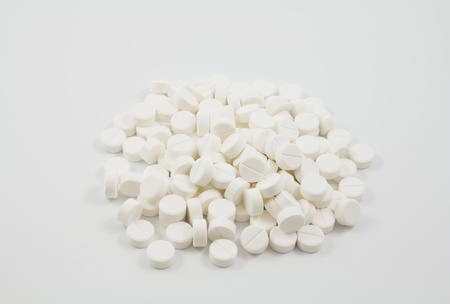 white tablets - medical background photo