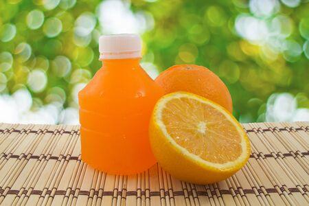 Orange fruit and a bottle with fresh orange juice Stock Photo