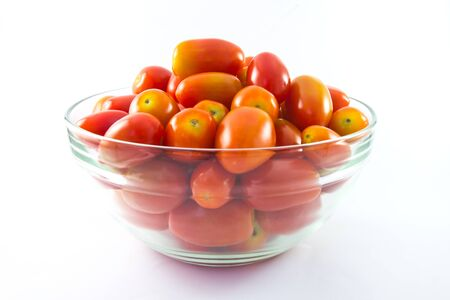 baby tomatoes in glass bowl on white background