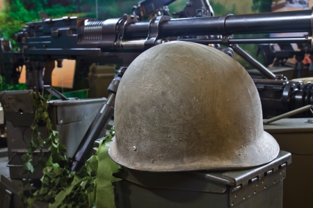 old army helmet and weapon