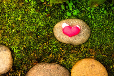valentines day background with hearts on green moss