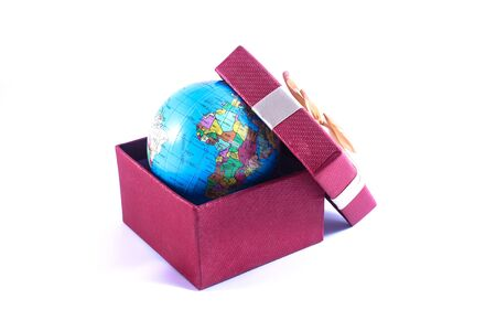 A world globe in a gift box on white background Stock Photo