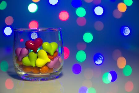 Multicolor heart shape in glass with bokeh background
