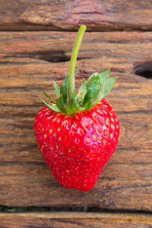 Close up of strawberry on wooden background Stock Photo