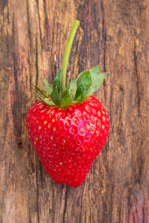 Close up of strawberry on wooden background Standard-Bild