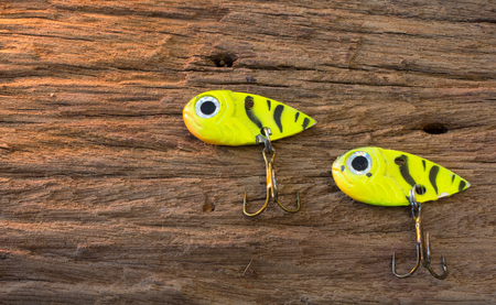 Fishing hook on wood background Stock Photo