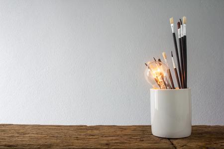 Brush and light bulb, art idea concept.