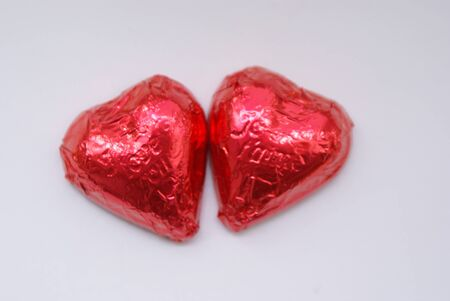 he is different: pair of red chocolate hearts