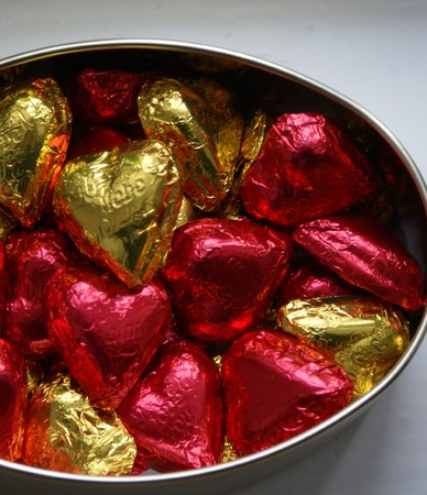 he is different: box of heart shaped chocolate sweets Stock Photo