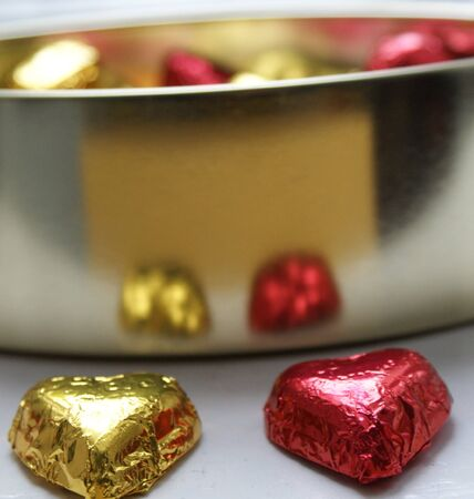 he is different: two hearts of a chocolate valentine box Stock Photo