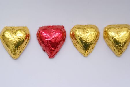 he is different: row of red and golden hearts Stock Photo