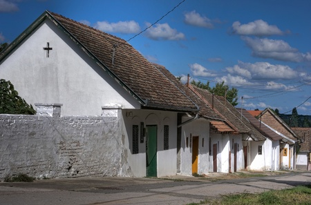 Ancient white houses with tile roof photo